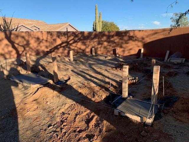 Arizona Creations Landscaping Worker Setting Concrete in backyard in Maricopa County AZ